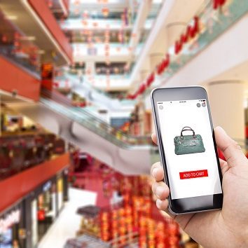 mobile phone with online shopping in modern shopping mall